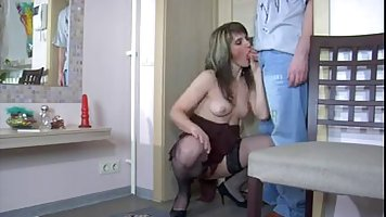 Lady in black lingerie gets cock in pussy from a young boy