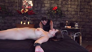 Naked Mature bitch tied up and began to experiment on her pussy